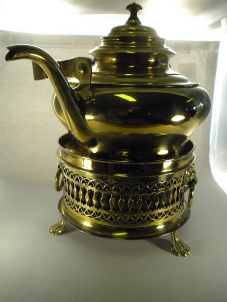 Antique brass kettle on tealight